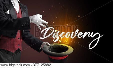 Magician is showing magic trick with Discovery inscription, traveling concept