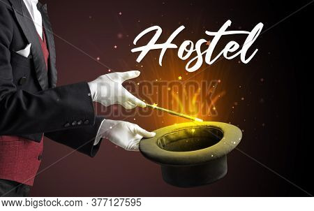 Magician is showing magic trick with Hostel inscription, traveling concept