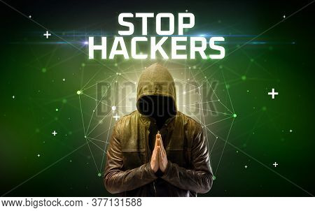Mysterious hacker with STOP HACKERS inscription, online attack concept inscription, online security concept