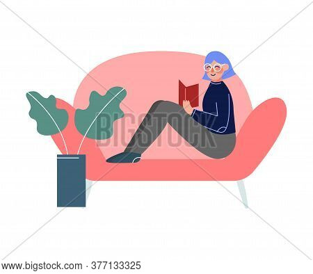 Girl Sitting On The Sofa And Reading A Book, Female College Or University Student, Young Woman Enjoy
