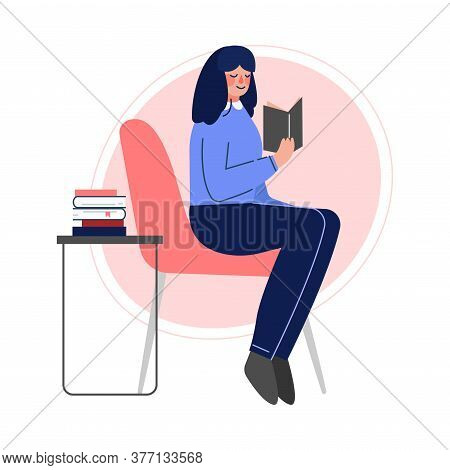 Girl Sitting On A Chair And Reading A Book, Female College Or University Student, Young Woman Spendi