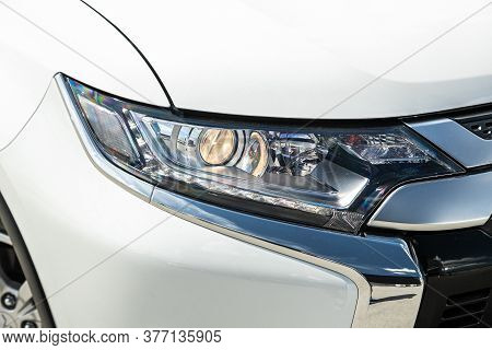 White Car Headlights. Exterior Detail. Close Up Detail On One Of The Led Headlights Modern Car.