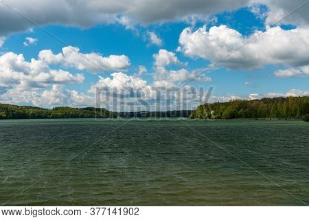 Terlicko Water Reservoir In Czech Republic During Windy Sprringtime Day With Blue Sky And Clouds