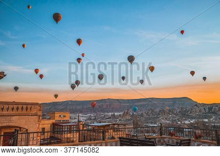 Cappadocia, Turkey - December 20, 2019: Hot Air Balloons Flying In Blue Sky With White Clouds Over H