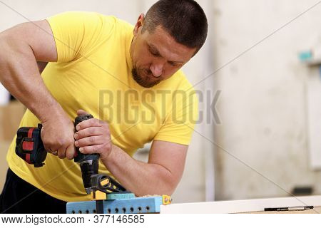 Carpenter Working On Wood Craft At Workshop To Produce Wooden Furniture. Caucasian Carpenter Use Pro