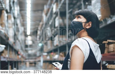 Female Buyer In Protective Face Mask Holding Smartphone Shopping In Store While Her Pregnancy. Young