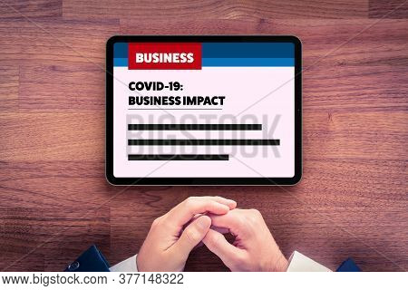 Covid-19 Business Impact News Concept. Businessman Read On Digital Tablet News Or Analysis About Imp