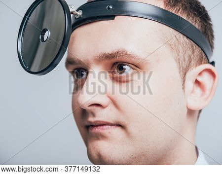 Medical Frontal Reflector On The Doctors Head