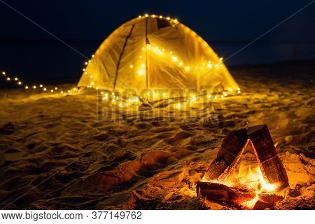 The Fire At Night On The Beach. Summer Mood