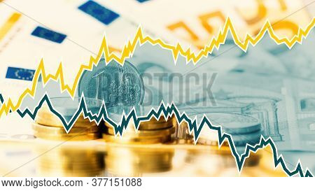 Euro Coins In Stacks On Euro Banknotes With Graphic For Stock Exchange Chart Or Stock Market Perform