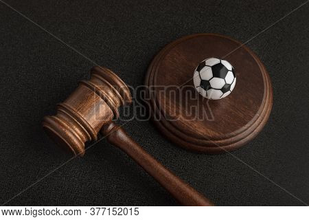 Wooden Judge Gavel And Toy Soccer Ball. Football Coach Accused. Concussion Lawsuit