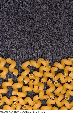 Raw Cavatappi Or Cellentani On Gray Background. Vertical Frame. Italian Cuisine
