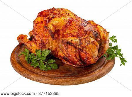 Homemade Chicken Rotisserie On Wooden Cutting Board