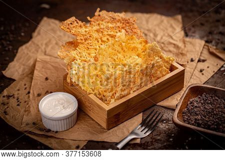 Crunchy Chips From Cheddar Cheese Served With Sauce