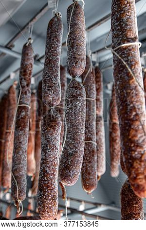Dried-up Salami Hanged Up In The Warehouse, Close Up Shot