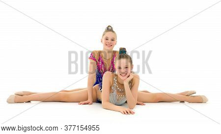 Girls Gymnasts Together Make A Twine. The Concept Of People, Sport, Fitness, Healthy Lifestyle. Isol