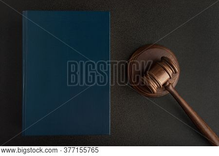 Legal Judge Hammer Or Mallet And Law Books On Black Background. Jurisprudence. Laws And Justice.