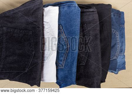 Different Pairs Of Jeans Various Colors And Textures, Folded Back Pockets Up, Fragment Top View Clos