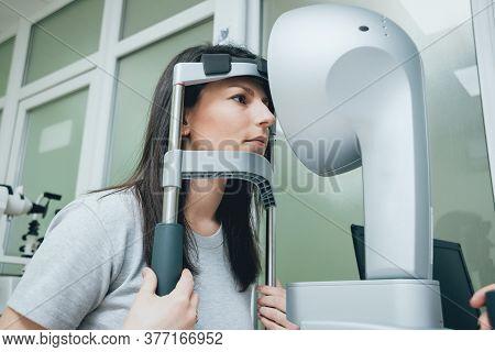 Optometrist Is Doing Corneal Topography. Corneal Exam. Ophthalmology Clinic