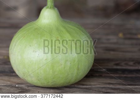 Bottle Gourd, Calabash Gourd Or Flowered Gourd On Wooden Table.