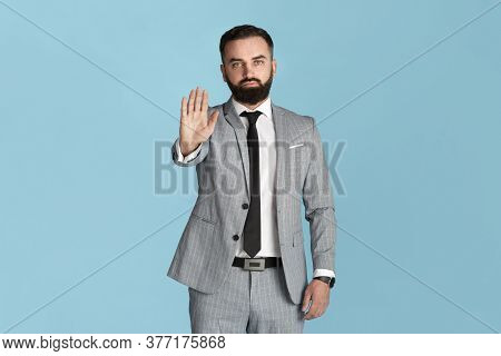 Expressing Rejection. Confident Entrepreneur In Formalwear Showing Stop Gesture On Blue Background