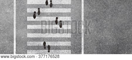 Abstract Image Aerial View Of Footprint Walking In Opposite Direction On White Pedestrian Crosswalk