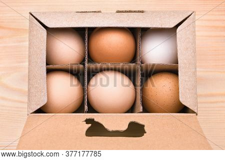 Free Grazing Of Hens. Chicken Products In A Cardboard Box. Exclusive Agricultural Method. Cardboard