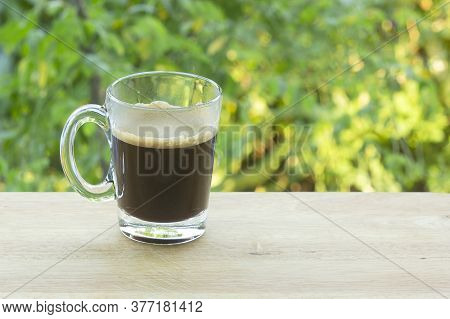Thai Black  Coffee On  Wooden Bar Served In The Garden