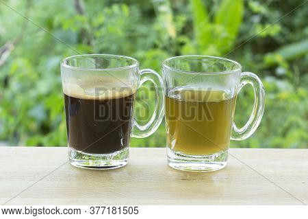 Thai Black Coffee And Hot Tea On  Wooden Bar Served In The Garden