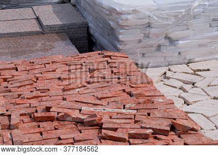 Tiles For Decoration And Design In Construction. Construction Materials. Red Stones Are Sold In Cons