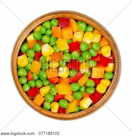 Mixed Vegetables In A Wooden Bowl. Colorful Veggie Mix Of Green Peas, Corn, Carrot Cubes And Diced B