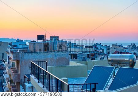 Rooftops of Heraklion and sunset sky, Crete, Greece