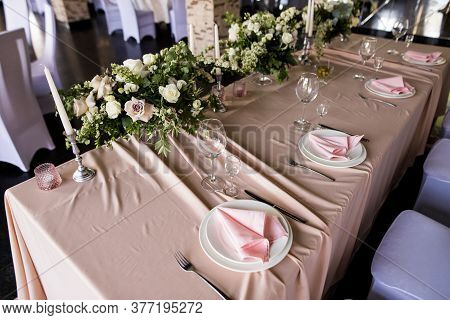 Top View Of The Presidium Table Setting With Empty Wine Glasses. Selebration Banquet With Plates And
