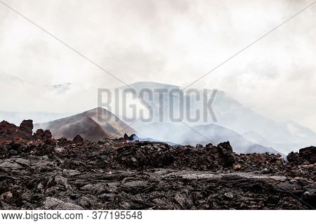 Foggy Volcanic Landscape Near Volcano Tolbachik In The Overcast Weather. Kamchatka Peninsula, Russia