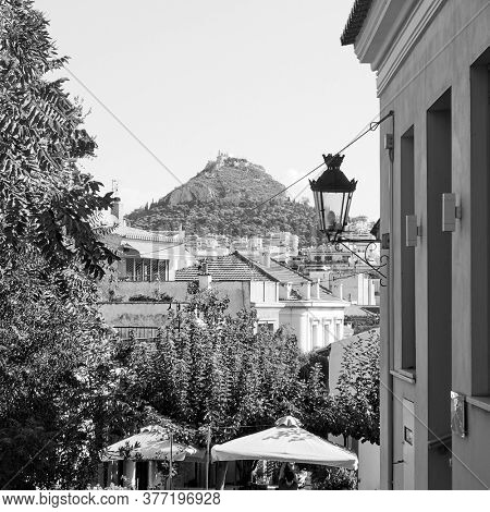 Plaka district and Lycabettus hill in Athens, Greece. Black and white photography, cityscape