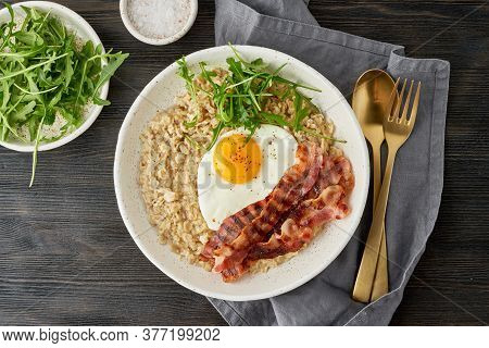 Oatmeal, Fried Egg And Fried Bacon. Balance Of Proteins, Fats, Carbohydrates. Close Up