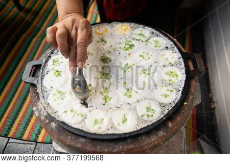 Hand And Spoon Picking Kanom Krok Or Kind Of Thai Sweetmeat, Thai Dessert On A Tray ,making Candy.