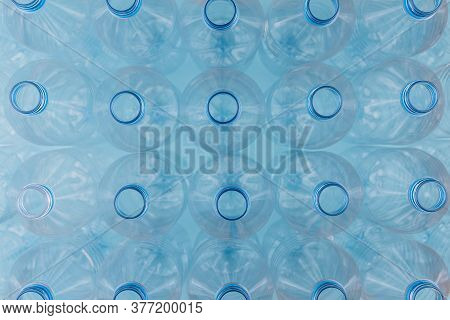 Horizontal Color Image With An Overhead View Of An Empty Clear Plastic Bottles Without Caps Stacked