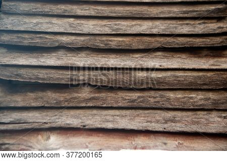 The Cracked Surface Of An Old Wooden Wall Texture Or Background.