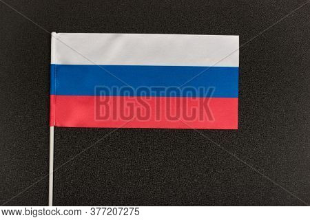 Flag Of Russian Federation On Black Background. National Symbol Of Russian Federation.