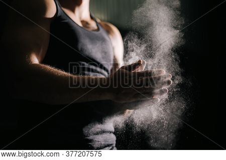 Close-up Of Unrecognizable Muscular Man Clapping Hands With Talc And Preparing For Workout At Gym. C