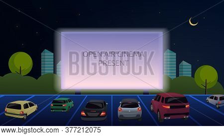 Open-air Cinema For Street Cars. Cars Watch A Movie In An Open Parking Lot At Night. Large Outdoor S