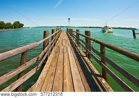 Wooden Mooring For Mooring Cruise Ships On A Bavarian Lake Chiemsee In Germany. Retro Style