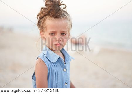 Little Girl Crying Beach. Sad Summer Vacation. The Child Is Lost Scared Small Adorable Caucasian Kid