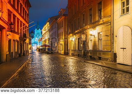 Riga, Latvia - July 3, 2016: Evening View Of Pils Street With Ancient Architecture In Bright Warm Ye
