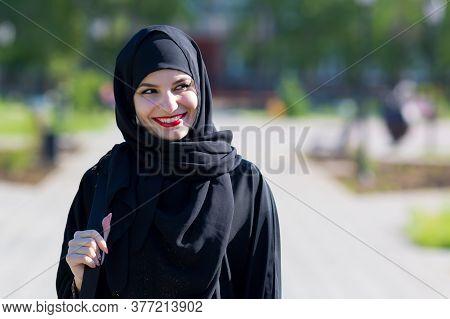 A Happy Muslim Woman In Oriental Clothes Walks. A Happy Muslim Woman In Oriental Clothes Walks Beaut