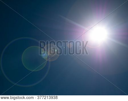 The Sun On The Background Of A Blue Cloudless Sky. Cloudy Landscape. Nature. Space. Sunlight. Sun Gl