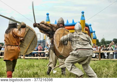 Russia, Staraya Ladoga 23,06,2012 Reenactors With Shields And Spears During The Battle, The Festival