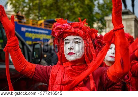 London - October 18, 2019: Close Up Of Red Brigade Protesters At An Extinction Rebellion Protest