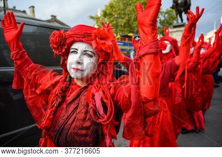 London - October 18, 2019: Red Brigade Protesters At An Extinction Rebellion Protest